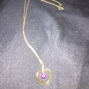Gold necklace with amethyst heart pendant